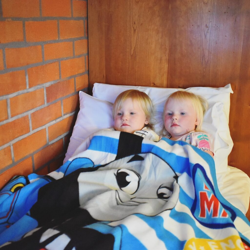 twins in a Thomas blanket at Drayton Manor Hotel