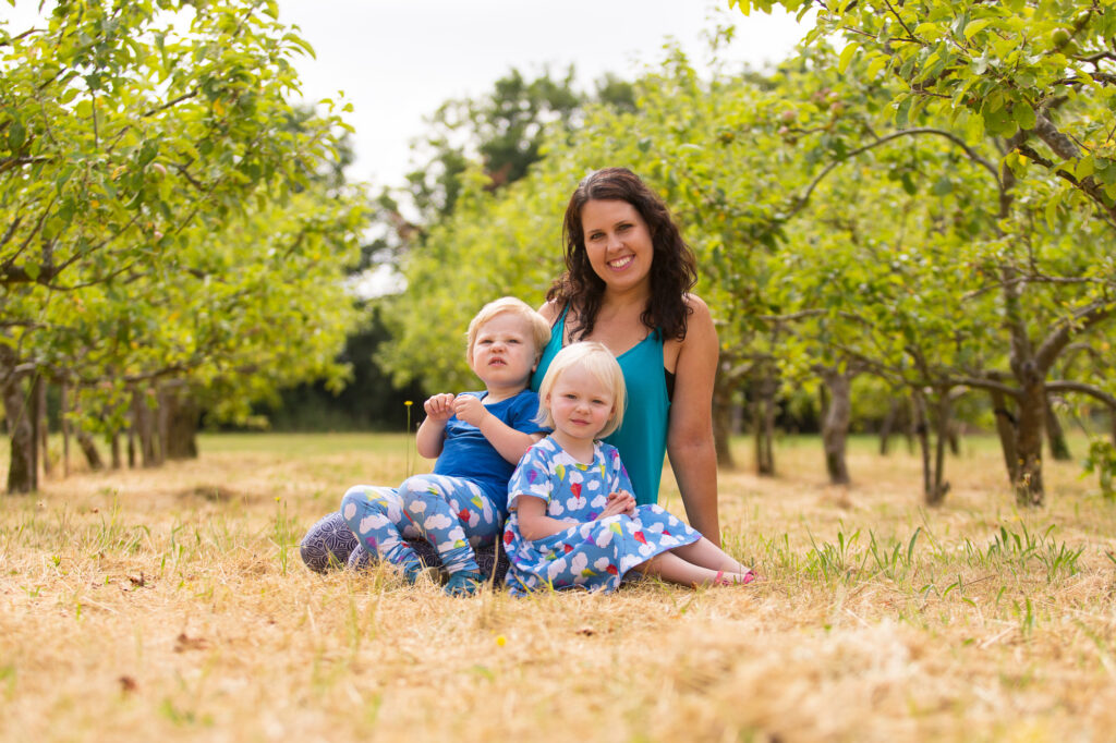 Mother and twins in orchard by Surrey photographer Rachel Thornhill