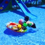 twins in swimming pool