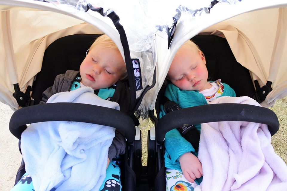 sleeping twins in pushchair