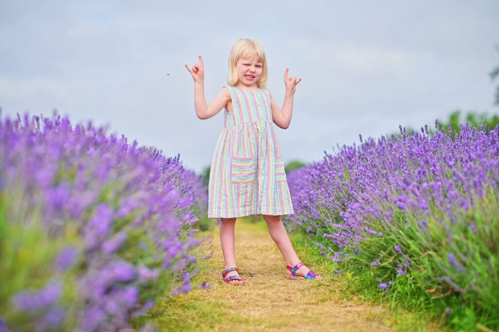 Girl doing a rock sign in lavender