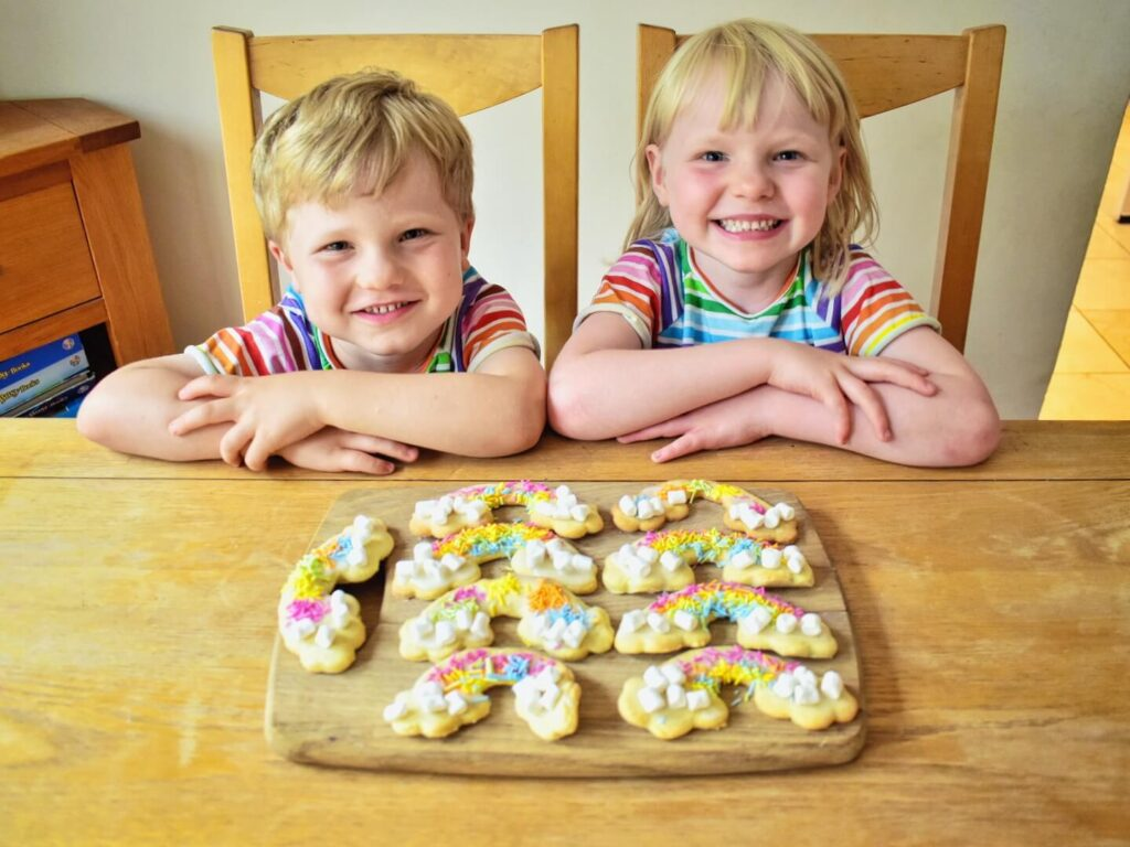 twins with rainbow biscuits
