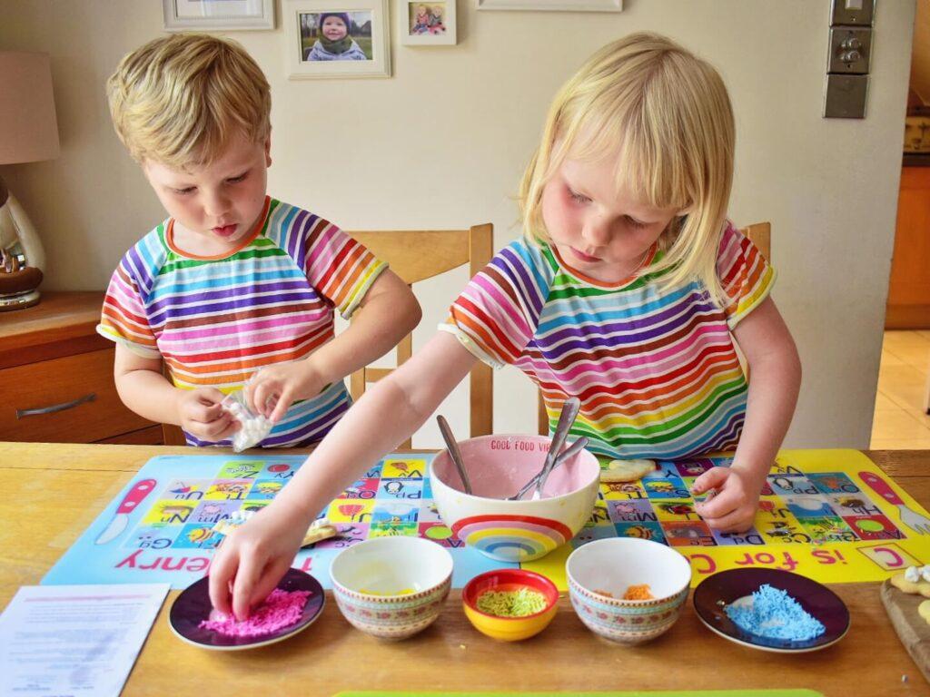 decorating rainbow biscuits