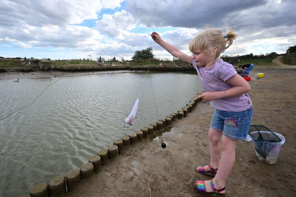 girl throwing crabbing line in Walberswick