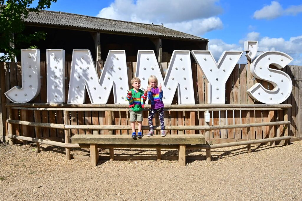 Twins at Jimmy's Farm on a family holiday in Suffolk