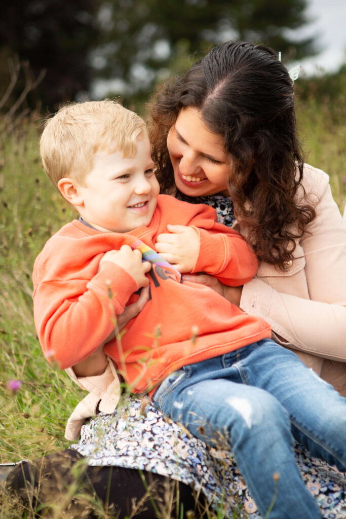 Mother and son smiling and cuddling family photography Surrey